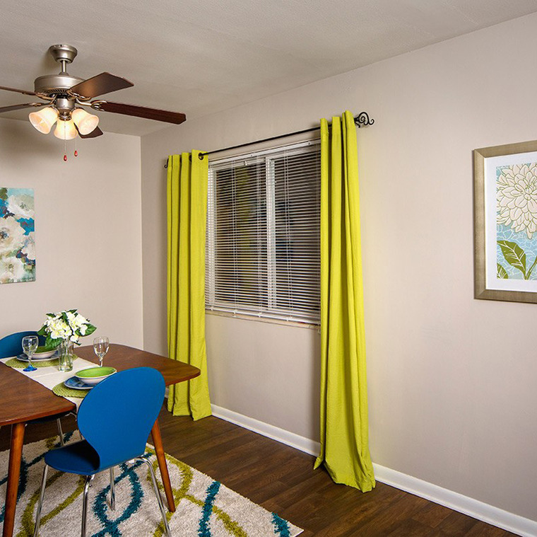 Dining Room with Wooden Table and Green Curtains