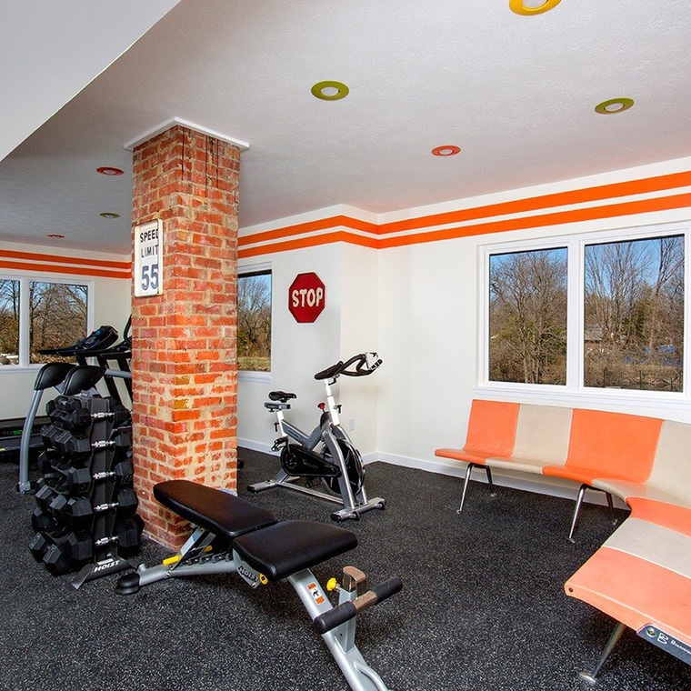 Fitness Room with Bike and Weight Bench