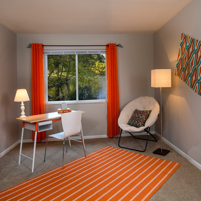 Room with Desk, White Chair and Orange Curtains